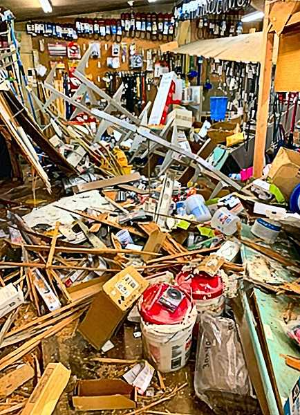 COURTESY OF PEGG CASSINELLI-BEESON  - Heres the huge mess caused by the errant pickup truck inside Wichita Feed & Hardware last November on Johnson Creek Boulevard. It took months to clean up, reorder, and repair - all done while also staying open during regular hours.
