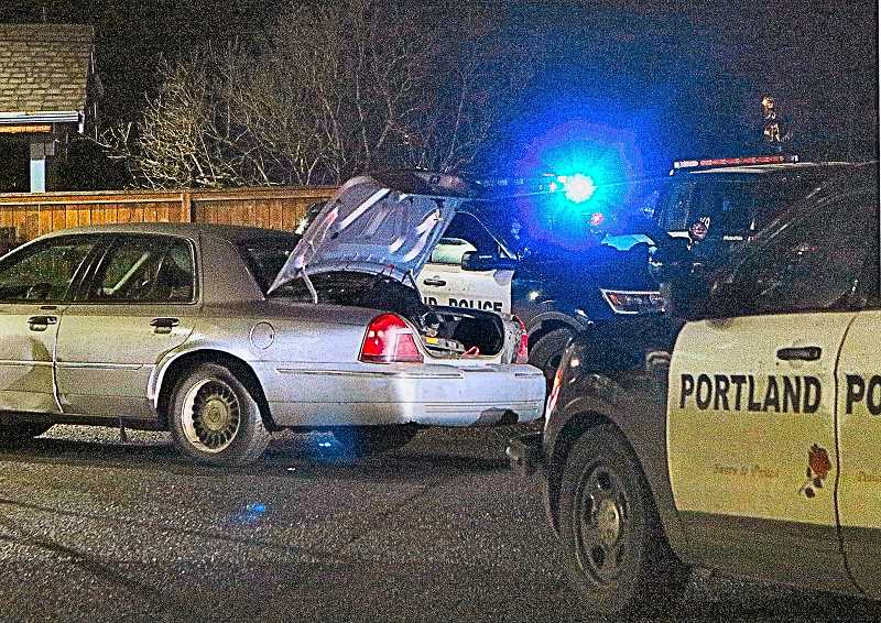 DAVID F. ASHTON - Portland Police patrol cars blocked in this Mercurysedan when the refused to stop over a license plate issue - and then ran off. Whatever officers then found in the trunk has led them to keep the investigation open while they look for the missing driver.
