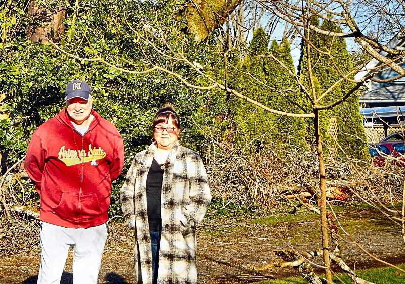 ELIZABETH USSHER GROFF - Mick and Hollie Scanlans home suffered major losses after ice on top of snow on power lines brought down powerlines at S.E. 42nd at Ramona Street. Vigilant neighbors alerted them of the danger of hanging wires after the fiery power transformer explosion.