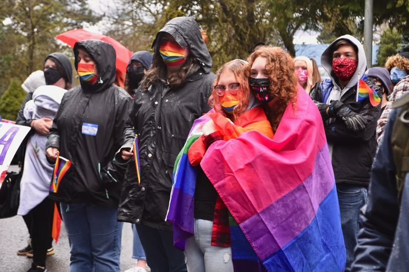 PMG PHOTO: BRITTANY ALLEN - Several people who attended the Have a Gay Day event in Sandy on March 20 wore or carried rainbow flags and/or flags representing the bisexual, pansexual or transgender communities.