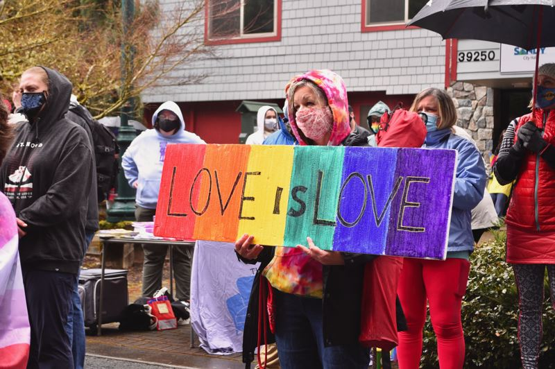PMG PHOTO: BRITTANY ALLEN - Many at the Have a Gay Day rally held signs saying things like 'Love is love,' 'Gay is natural' and 'If God hates gays, why are we so cute?'