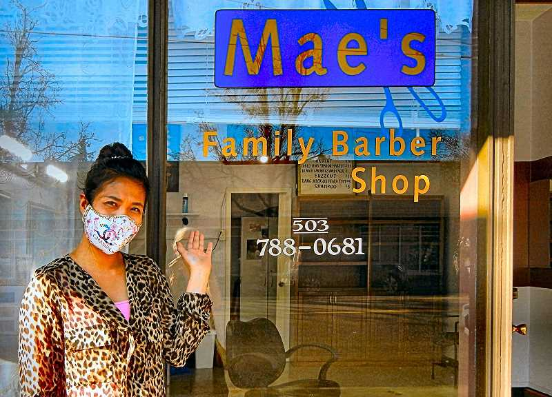 ELIZABETH USSHER GROFF - Maes Barber Shop in is now run by her daughter-in-law, Theavy Tep - who is following in Maes footsteps as a popular, expert, and affordable Woodstock neighborhood haircutter.