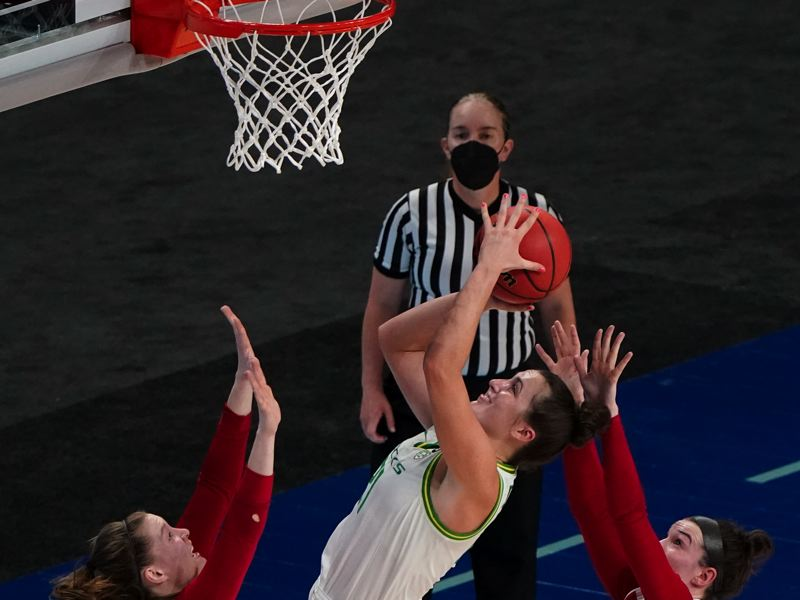 COURTESY PHOTO: NCAA PHOTOS - Erin Boley goes up for two of her 22 points Monday as the Oregon Ducks beat South Dakota in the first round of the NCAA Women's Basketball Tournament.