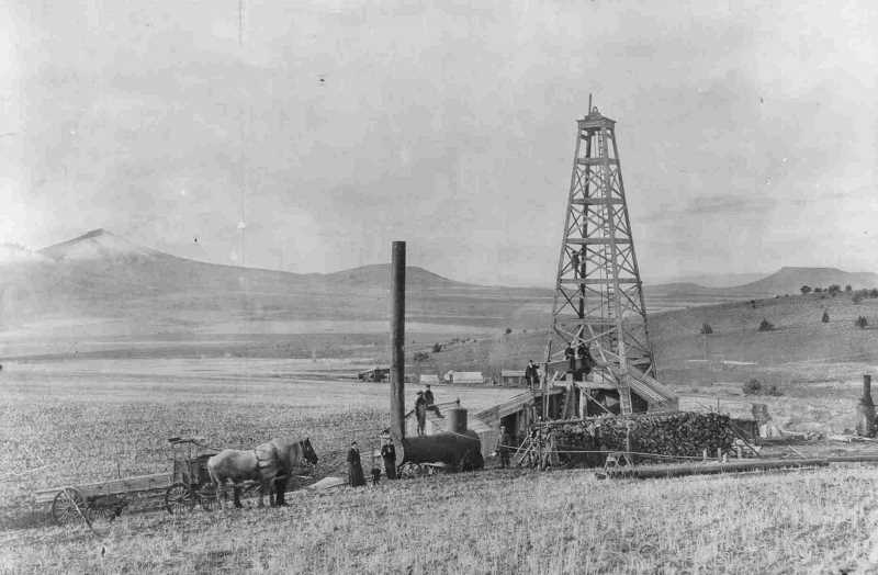 PHOTO COURTESY OF BOWMAN MUSEUM  - Oil Well on west slope of Grizzly was drilled in 1908.