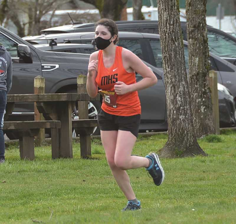 COURTESY PHOTO - Crista Baurer traverses the course Monday at the North Marion dual meet.