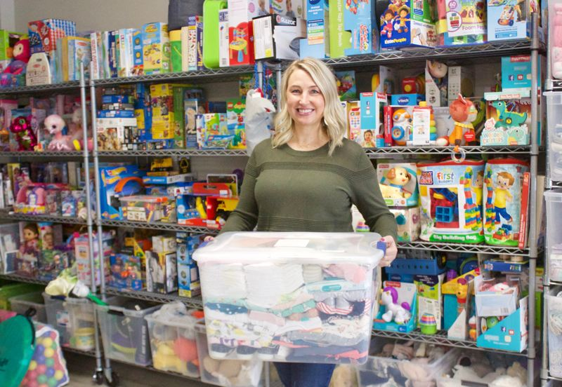 PMG PHOTO: CHRISTOPHER KEIZUR - Lyndsee Wunn founded Boxes of Love to give children entering the foster care system tangible possessions.