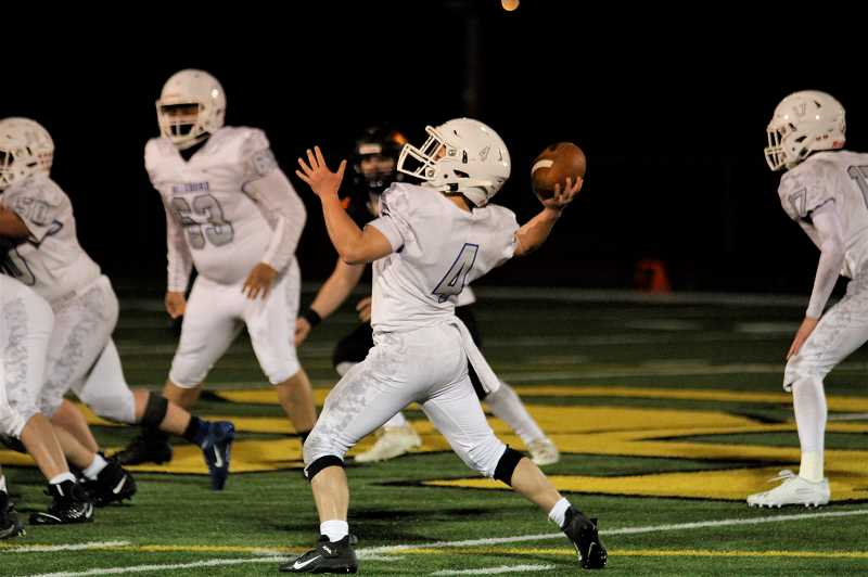 PMG PHOTO: WADE EVANSON - Hillsboro freshman quarterback Calvin Perkins throws a pass during the Spartans' game with Scappoose Friday night, March 19, at St. Helens High School.