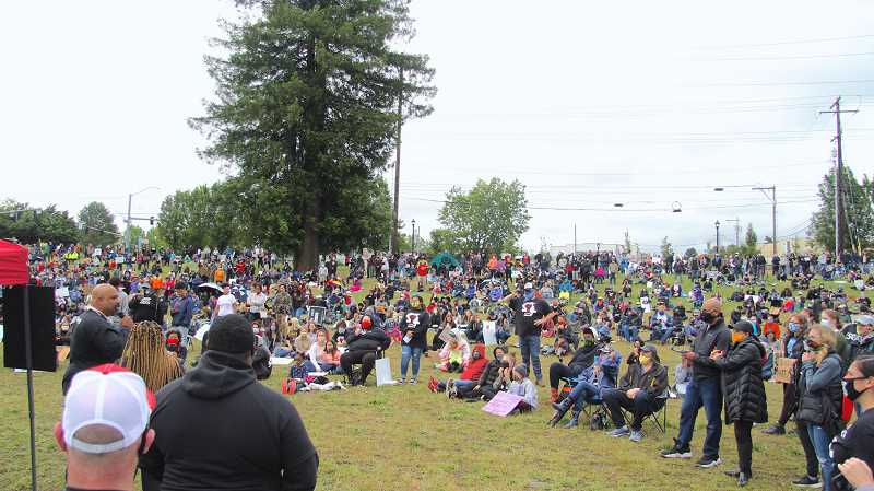 PMG PHOTO: SAM STITES - More than 500 people lined the hill in Milwaukie Bay Park on June 9, for a sit-in supporting the Black Lives Matter movement.
