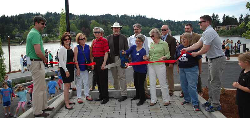 PMG PHOTO: KATHY SCHAUB - Leaders cut the ribbon to the mark the grand opening of Milwaukie Riverfront Park in 2015.