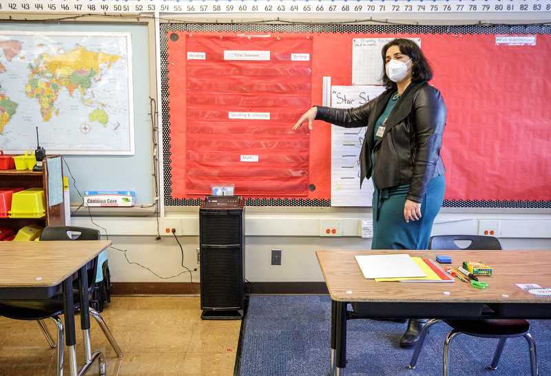 PMG PHOTO: JON HOUSE - Alma Velazquez, principal at Jason Lee Elementary School, points out an air purifier with a HEPA filter in a classroom. Portland Public Schools has promised to equip all classrooms with HEPA filters to help combat the spread of COVID-19 as teachers and students prepare to come back to school.