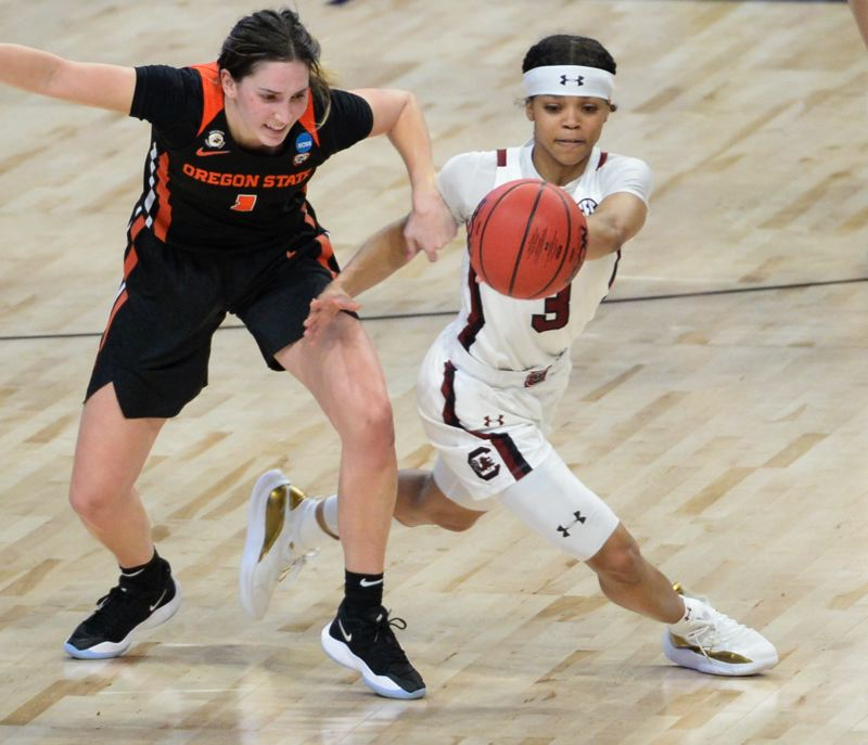 COURTESY PHOTO: NCAA PHOTOS - South Carolina's Destanni Henderson makes a steal of Oregon State's Aleah Goodman and went in for a layup, as part of the Gamecocks' stellar quarter in their 59-42 NCAA tourney win.