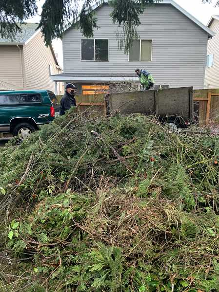 Oregon City Optimist Club and city officials organized volunteers to clear out debris from 50 households who were physically unable to haul fallen trees and branches from their properties.