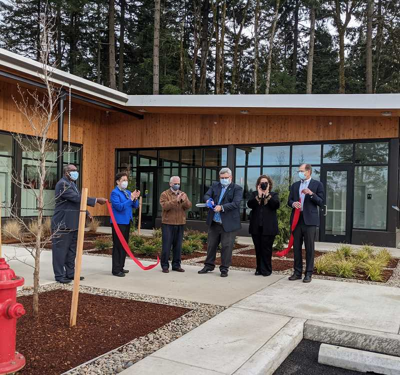 COURTESY PHOTO: CITY OF TIGARD - Komi Kalevor, Kathryn Harrington, Roy Rogers, Tigard Mayor Jason Snider, Julie Cody and Walter (Skip) Grodahl all aid in a ribbon cutting ceremony at The Fields Apartments in December.