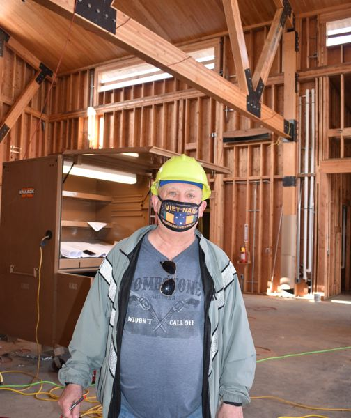 PMG PHOTO: TERESA CARSON - Terry Sprague, who is working on the new Wood Village City Hall, sees light at the end of the tunnel. He's planning an anniversary party in the new building.