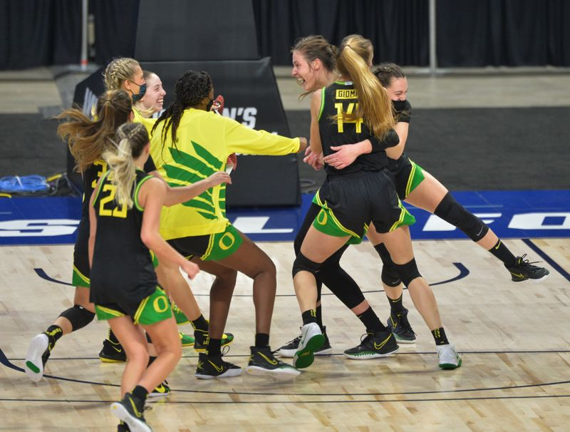 COURTESY PHOTO: NCAA PHOTOS - Members of the Oregon women's basketball race to embrace Sedona Prince at the conclusion of the Ducks 57-50 upset win over Georgia on Wednesday in the second round of the NCAA Women's Basketball Tournament.