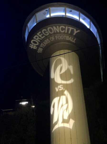 COURTESY PHOTO: ROCKY SMITH - Oregon City started lighting up its Municipal Elevator this week to get people excited about the 100th rivalry high school football game.