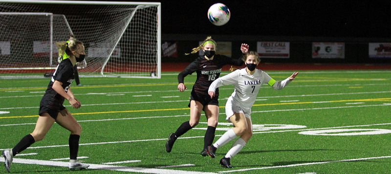 PMG PHOTO: MILES VANCE - Lake Oswego senior Rachel Sasadeusz gets ready to make a play during her teams 3-2 loss to Sherwood at Sherwood High School on Wednesday, March 24.