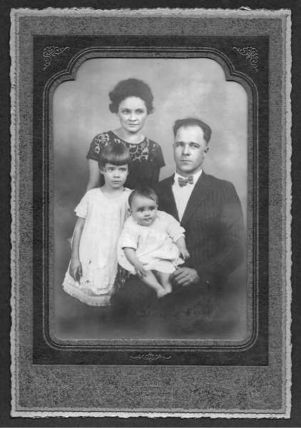 COURTESY PHOTO: JEANNE MULLEN - As a baby, Betty Dargis sits on the lap of her father in a family portrait with her sister Virginia and mother Maria.