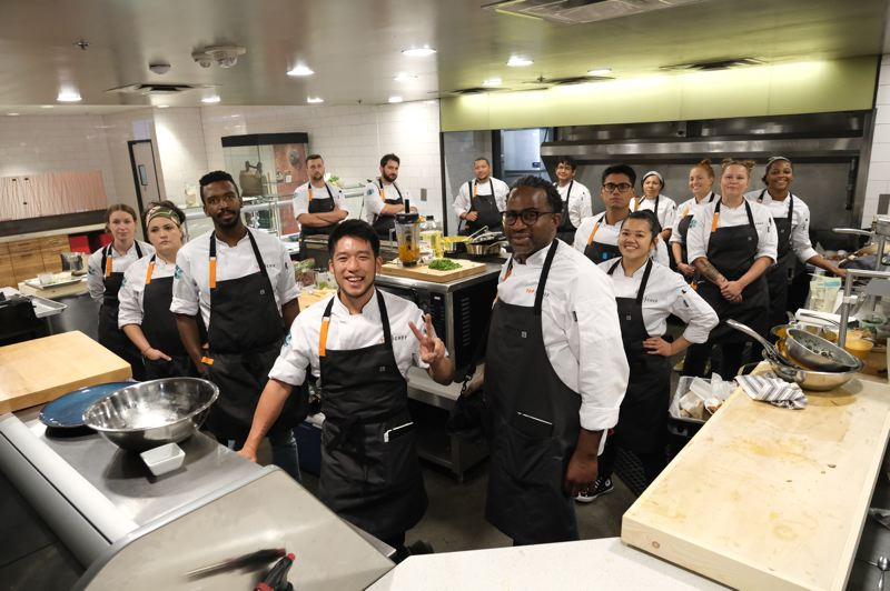 COURTESY PHOTO: BRAVO NETWORK - The cast of Season 18 of 'Top Chef' spent last fall in Portland, and includes local chefs Sara Hauman (far left) and Gabriel Pascuzzi (fourth from left in background)