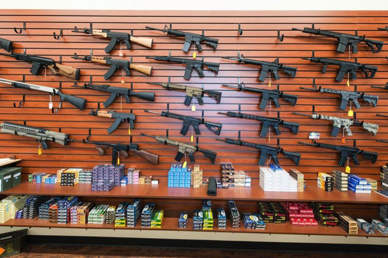 PMG FILE PHOTO - Assault-style rifles and other weapons for sale at an Oregon gun store.