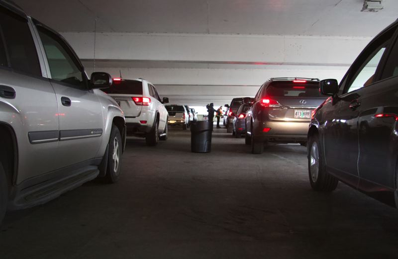 PMG PHOTO: SAM STITES - Two lines of cars snake through the parking garage on the northeast end of the Clackamas Town Center where the county's public health division is administering 3,000 shots between Friday, March 26 and Saturday, March 27.