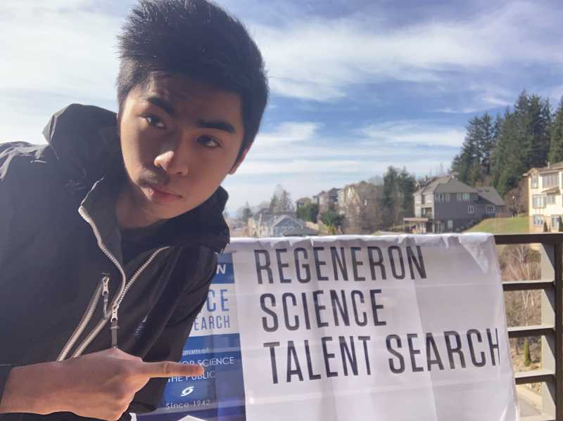 COURTESY PHOTO - Wenjun Hou points to a flag representing the Regeneron Science Talent Search. Hou attends Jesuit High School and placed eighth in the competition, winning $60,000.