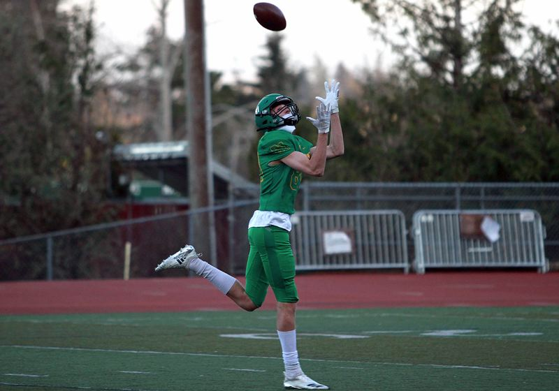 PMG PHOTO: MILES VANCE - West Linn senior Aiden Scott gets ready to make a catch for a 65-yard touchdown during his team's 42-7 win over Lake Oswego at West Linn High School on Friday, March 26.