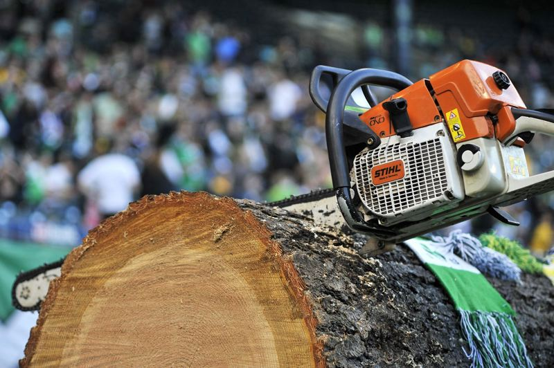 FILE - The Timbers lumberjack mascot leaves his chainsaw in a chunk of tree during halftime in 2010.