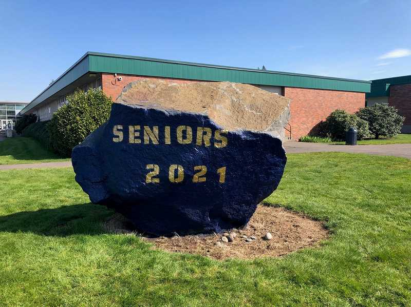 COURTESY PHOTO: KIMIE CARROLL - Canby's seniors painted over the Senior Rock to celebrate their graduation year.
