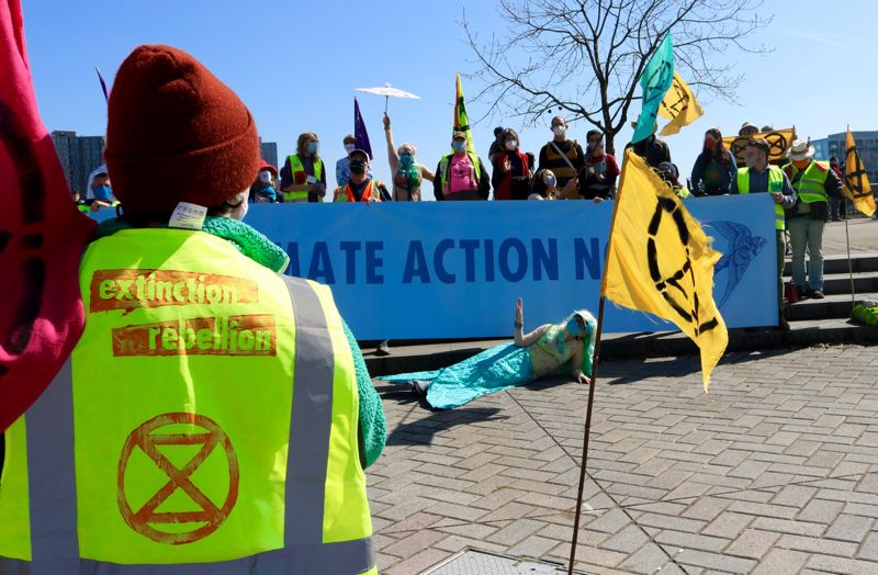 PMG PHOTO: ZANE SPARLING - Activists with Extinction Rebellion America, Cascadia Coalition gathered at the Bill Naito fountain in downtown Portland befor marching to the Morrison bridgehead Saturday afternoon, March 27.