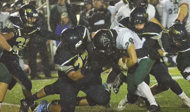 FILE PHOTO - The Canby High football team got big contributions from a number of players in its win over Scappoose Friday night.