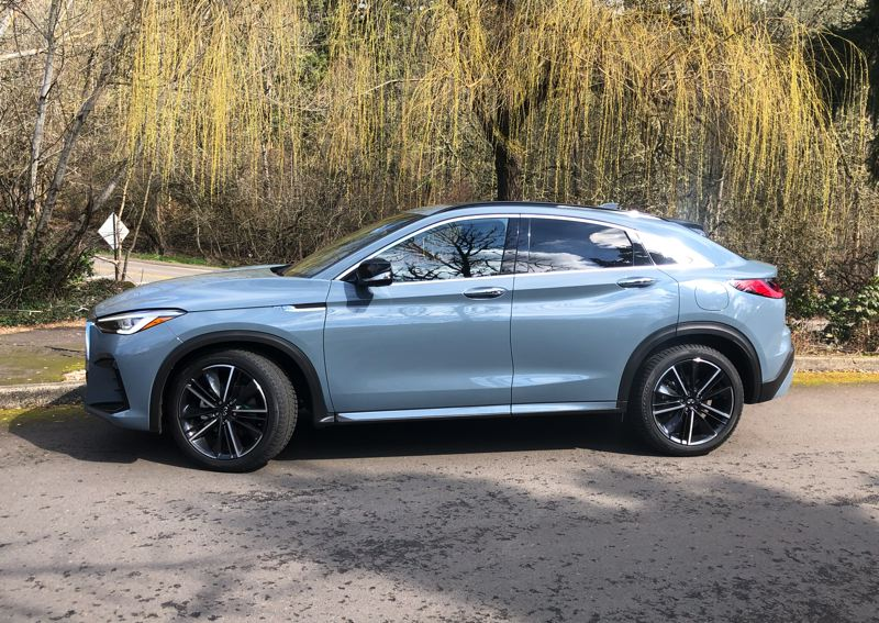 PMG PHOTO: JEFF ZURSCHMEIDE - A powerful turbocharged 2.0-liter engine and all-wheel-drive are standard on the 2022 Infiniti QX55.