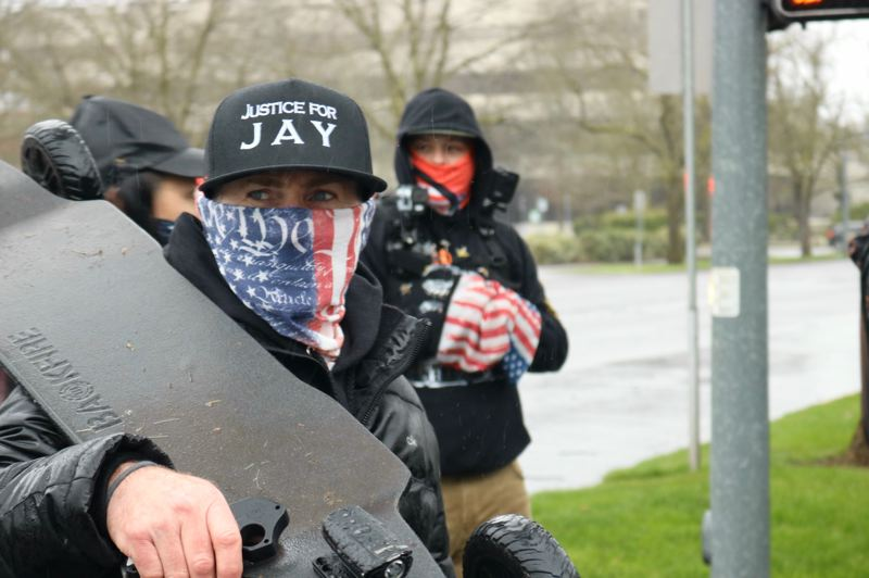 PMG PHOTO: ZANE SPARLING - A right wing protester outside the Oregon State Capitol on Sunday, March 28 wore a hat referencing the death of Aaron 'Jay' Danielson.