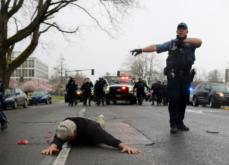 PMG PHOTO: ZANE SPARLING - A man who had pulled out a handgun after protesters attacked his car was detained in Salem on March 28.