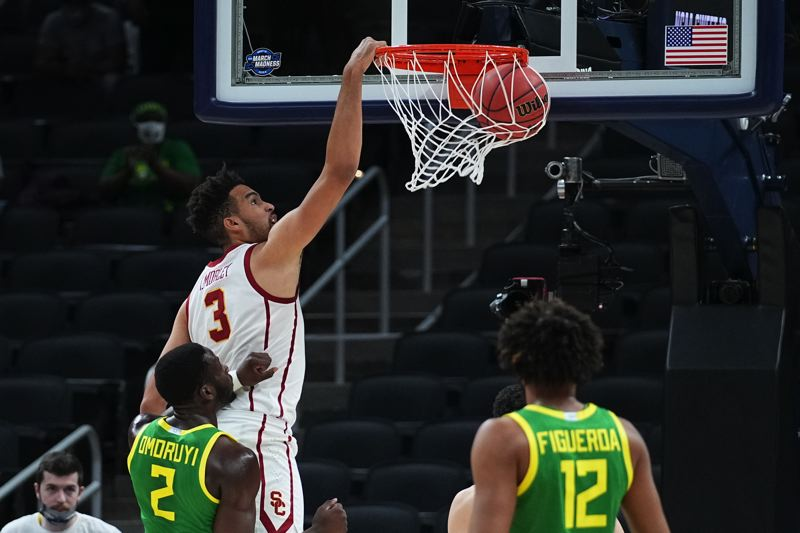 COURTESY PHOTO: NCAA PHOTOS - Isaiah Mobley dunks against Oregon in USC's Sweet 16 win.