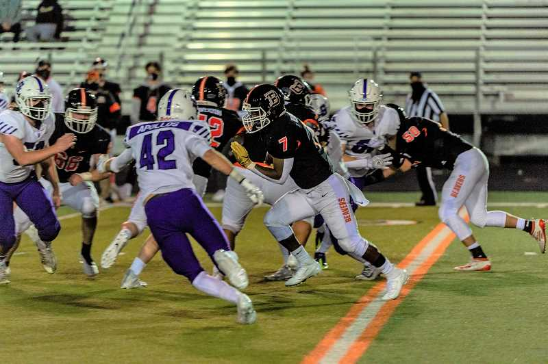 PMG PHOTO: DIEGO DIAZ - Sunset linebacker Aiden Timbo and a slew of Apollo tacklers trackdown Beaverton running back Koffi Kouame during Sunset's game with the Beavers Friday night, March 26, at Beaverton High School.