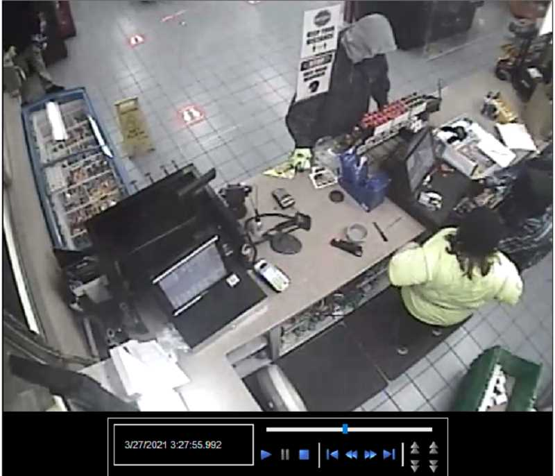 REDMOND POLICE DEPARTMENT PHOTO - Video surveillance at the Redmond Chevron Circle K shows the robbery and assault suspects.