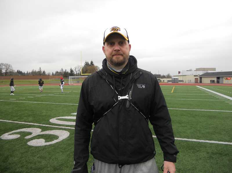 PMG PHOTO: SCOTT KEITH - St. Helens High School football coach Cory Young is on the field for an early morning practice.