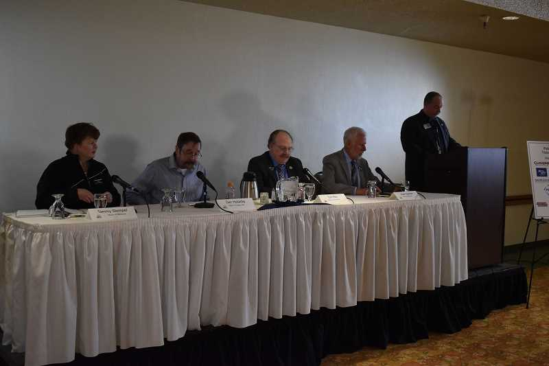 PMG PHOTO: RAYMOND RENDLEMAN - North Clackamas Chamber Board Chair Marc Kilman-Burnham (right) moderated the March 2020 event with mayors Tammy Stempel (from left) Dan Holladay, Tom Ellis and Mark Gamba, which turned out to be the last in-person chamber event before COVID cancellations.