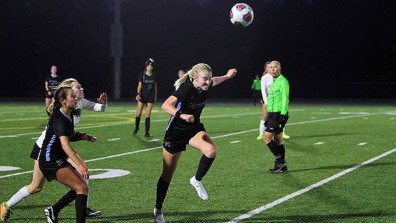 PMG PHOTO - Mountainside's Stella Bauman makes a running header during her teams win over West Linn in the Class 6A state quarterfinals in 2019. This year, Bauman has moved from forward to defender to solidy the teams defense.
