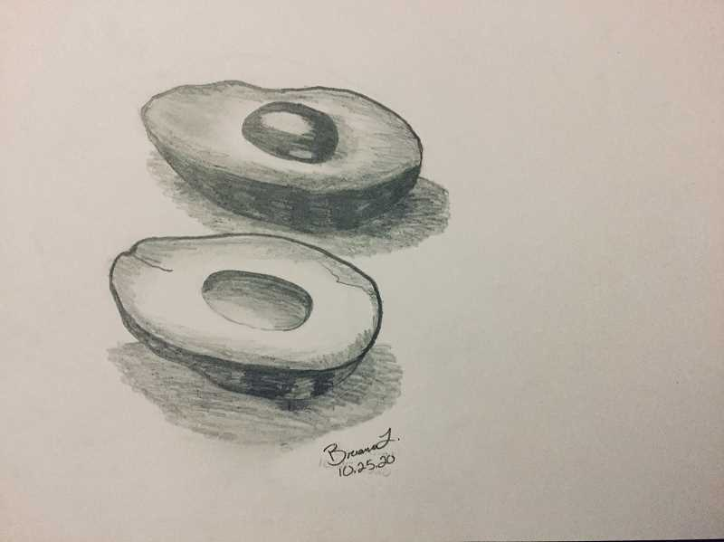 Canby seventh grader Brianna Lopez Garcia brings a pencil drawing of an avocado to the show with her piece titled 'Split.'
