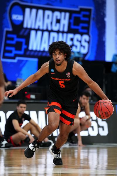 COURTESY PHOTO: NCAA PHOTOS - Ethan Thompson had a tough time offensively, defending by DeJon Jarreau, but he made some big baskets late in the loss.