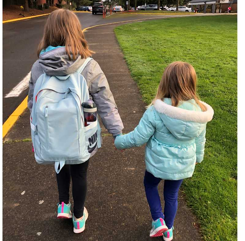 COURTESY PHOTO: TIGARD-TUALATIN SCHOOL DISTRICT - Two sisters hold hands as they walk to Bridgeport Elementary School on Monday.