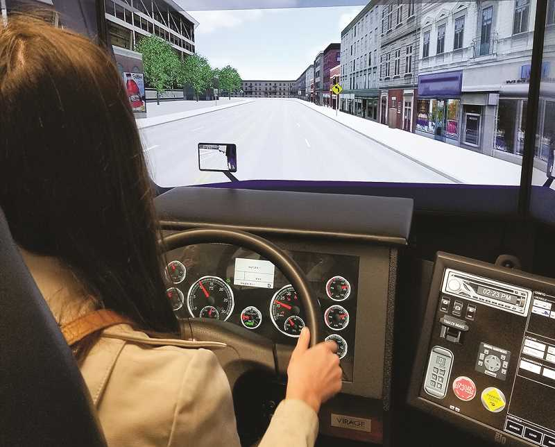 PHOTO COURTESY OF BAKER TECHNICAL INSTITUTE - A Baker Technical Institute student spends time in a truck driving simulator
