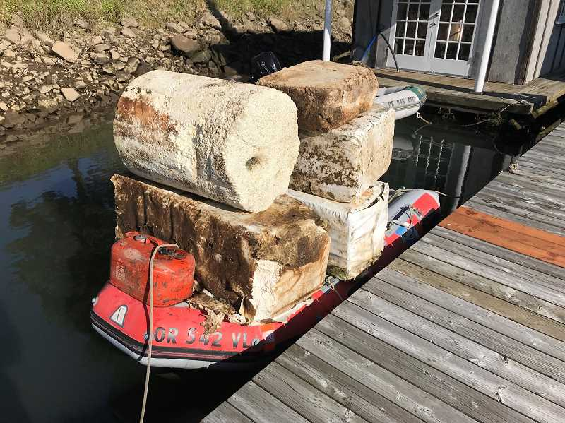 COURTESY PHOTO: HANNS HAEFKER - Foam barrels sit on a canoe in the Multnomah Channel.