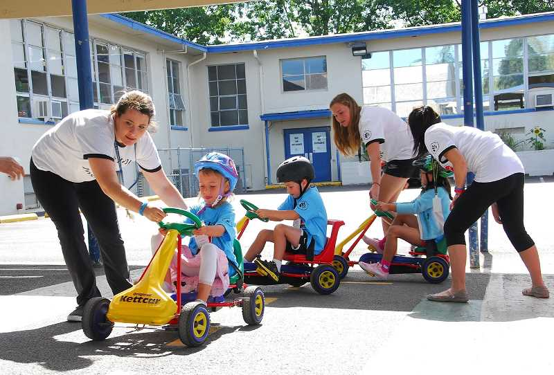 PMG PHOTO - Children take part in Tualatin Hills Park and Recreations Safety Town in 2016. THPRDs summer schedule that includes camps, classes and activities will be available online April 12.