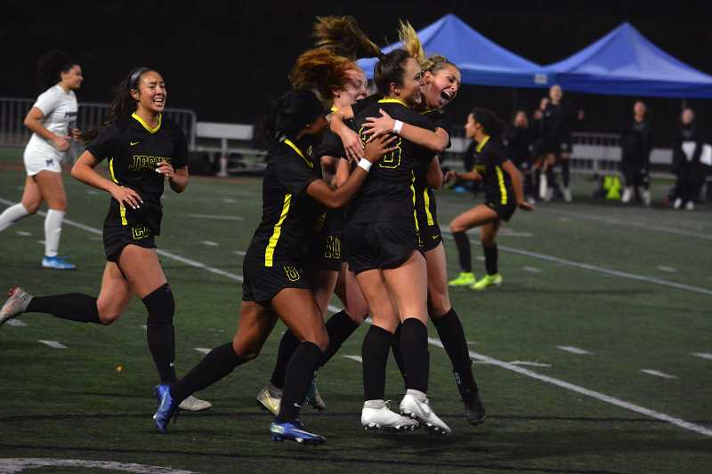 TIMES PHOTO: MATT SINGLEDECKER - Jesuit's Callan Harrington and the Crusader girls soccer team won their third straight Class 6A state title in 2019, defeating heated Metro League rival Mountainside in Class 6A state championship game.