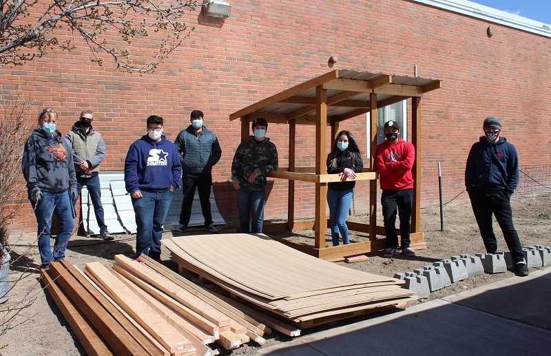 HOLLY SCHOLZ/MADRAS PIONEER  - Students in Sara Vollmer's senior agriculture class at Madras High School helped unload supplies they will use to build a chicken coop. A $2,000 grant from Wilco helped kickstart the project.