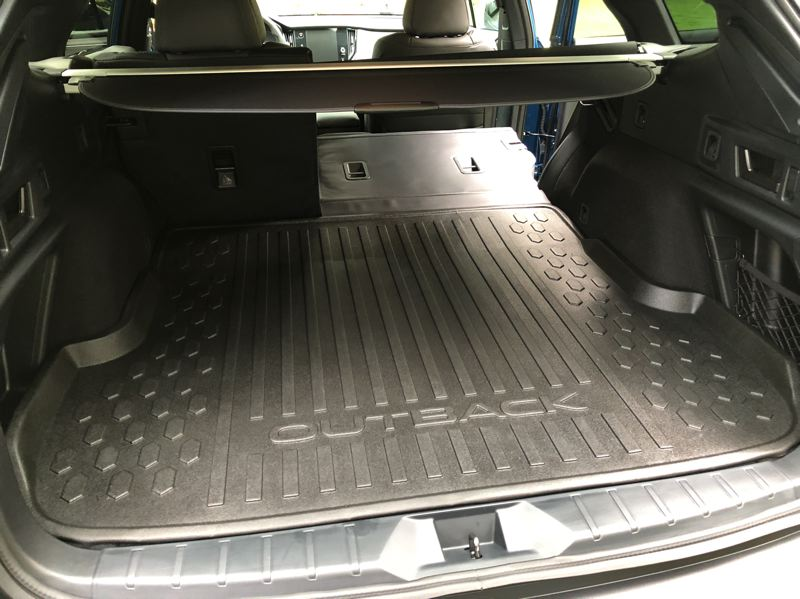 PMG PHOTO: JEFF ZURSCHMEIDE - In the cargo area, the rear seatback is wrapped in a waterproof material, and a waterproof rear cargo tray protects the load floor.