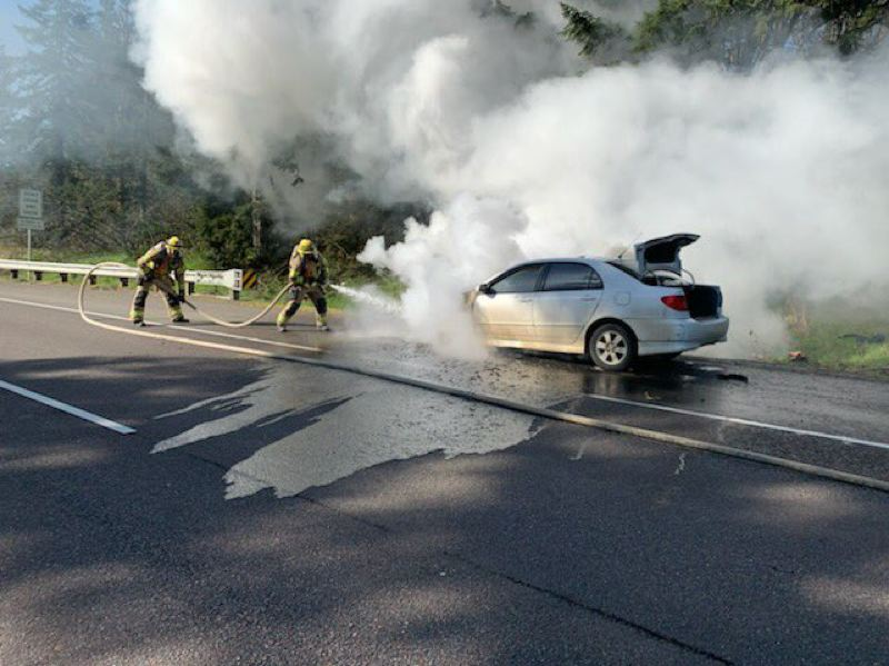 COURTESY PHOTO: TVF&R - Firefighters put out a fire started from a busted engine on Highway 551 near I-5.